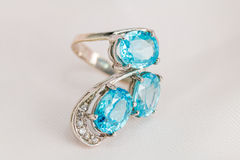 Old silver ring with blue topaz stone. Stock Image