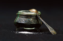 Old silver saltcellar on a black  background Royalty Free Stock Photo
