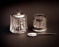 Old silver tea glass holder, spoon and glass sugar Royalty Free Stock Photos