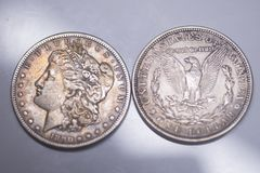 Old Silver US Coins. 1890 Morgan Dollar. Old Silver US Coins. Morgan silver dollars, all composed of 90% silver and 10% copper slightly less silver than sterling stock image