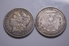 Old Silver US Coins. 1890 Morgan Dollar. Old Silver US Coins. Morgan silver dollars, all composed of 90% silver and 10% copper slightly less silver than sterling royalty free stock photo