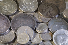 Old Silver US Coins. Of various denominations royalty free stock photos