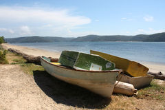 Wooden boats on the beach Stock Photos