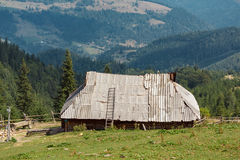 Old single house in mountains Royalty Free Stock Photo