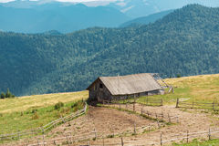 Old single house in mountains Stock Photos