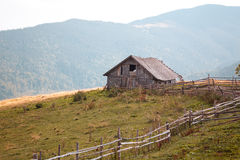 Old single house in mountains Stock Photography