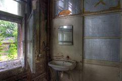 Old sink in an abandoned house Royalty Free Stock Image