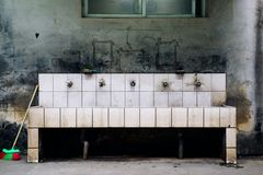 Old sink in school stock image