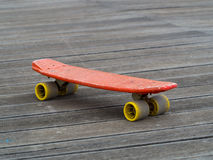 Old skate board on wooden surface Stock Photo