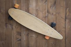 Old skateboard with copy space stock photography