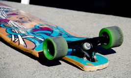 Old skateboard on a sidewalk at Alki beach Royalty Free Stock Image