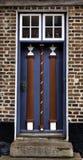 Old skewed door in Ribe, Denmark. Old antique skewed door in Ribe, Denmark Royalty Free Stock Photography