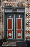 Old skewed door in Ribe, Denmark. Old antique skewed door in Ribe, Denmark Stock Images