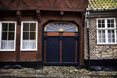 Old skewed door in Ribe, Denmark Royalty Free Stock Images