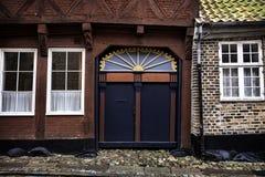 Old skewed door in Ribe, Denmark Royalty Free Stock Images