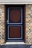 Old skewed door in Ribe, Denmark. Old antique skewed door in Ribe, Denmark Royalty Free Stock Images