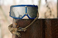 Old ski goggles in dust standing on wooden boards Royalty Free Stock Photo