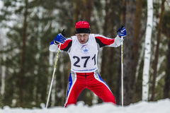 Old skier athlete men running through woods Stock Image