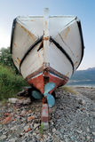 Old Skiff. On land to repair its propeller and body Royalty Free Stock Image