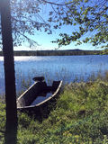 Old skiff. On the shoreline of a little lake in the North of Sweden Stock Images