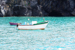 Old skiffs. Two morbid fishing boats on the green sea Royalty Free Stock Photography