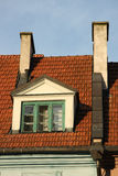 Old window on a tile roof Royalty Free Stock Image