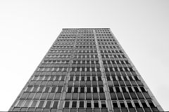 Old skyscraper, view from below. Black and white photo. Stock Photo