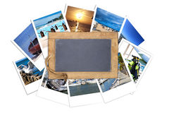 Old slate blackboard lies on a stack of instant pictures Royalty Free Stock Photo