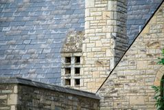 Old Slate Roof. A roof with several angles of an brick church Royalty Free Stock Image
