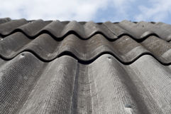 Old slate roof and blue sky. Vertical. Old slate roof and blue sky. Vertical image Stock Photos
