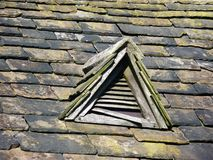 Old slated roof with wooden vent old cottage Royalty Free Stock Photos