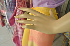 Old slender fingers and female manikin Royalty Free Stock Images