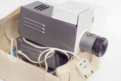 Old slide projector in a box. Close-up. Old slide projector in a box. Loaded with film. Closeup stock image