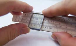Old slide rule slipstick analogue computer for mathematical calcululs. Old slide rule slipstick used as analogue computer for mathematical calcululs and Royalty Free Stock Image
