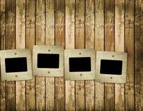 Old slides on the wooden background. Old slides on the abstract wooden background Stock Photos