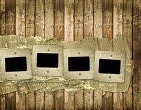 Old slides on the wooden background. Old slides on the abstract wooden background Royalty Free Stock Images