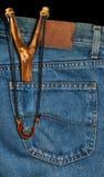Old Slingshot in Denim Pocket Stock Photos