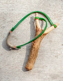The old slingshot on old wood background. Stock Photos