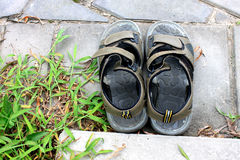 Old slippers black sandal on the ground floor Royalty Free Stock Photo