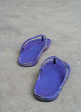Old slippers. On cement floor Stock Image