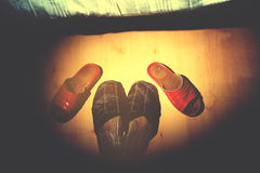 Old slippers on tile floor Stock Photo