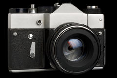 Old SLR camera. Old used SLR camera isolated over black Royalty Free Stock Image