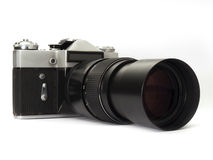 Old slr camera with tele lens Stock Photography