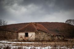 Old small abandoned house on meadow royalty free stock photography