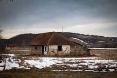 Old small abandoned house on meadow royalty free stock images