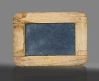 Old small blackboard. Old grunge small blackboard on grey background Royalty Free Stock Photos