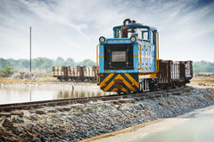 Old small blue locomotive and freight train Royalty Free Stock Image