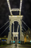 Old small bridge over the canal at night royalty free stock photos