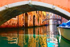 Small bridges over canal in Venice. Old small bridges over canal in Venice, Italy Royalty Free Stock Images