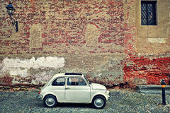 Free Old Small Car Against Brick Wall. Stock Photo - 36522530